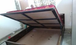 wooden bed with hydraulic storage