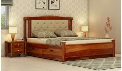 double bed with tufted headboard and storage drawers beneath