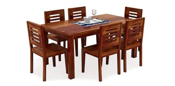 Which one is better- Wood or glass top dining table?