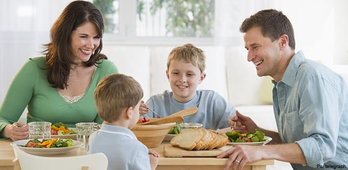 Family Eating Food on Dining Table
