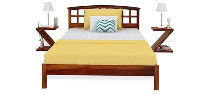 spacious wooden single beds